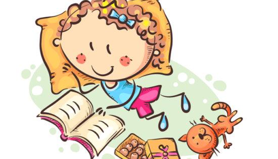 横になりながらマンガを読む子供